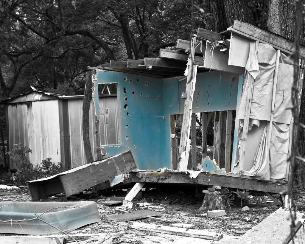 Wrecked trailer home from Lost Trailer Park series